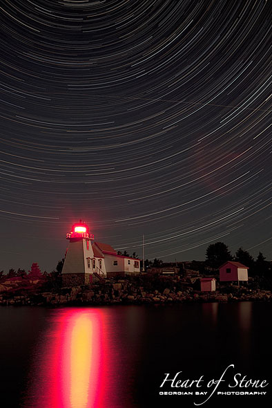 Star trails over lighthouse, Pointe au Baril, Georgian Bay