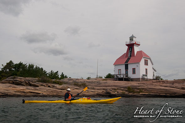 Snug Harbour lighthouse and kayaker, Snug Harbour, Georgian Bay