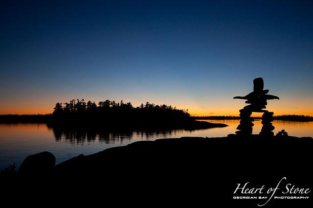 Inukshuk silhouette at sunset, Sans Souci, Georgian Bay