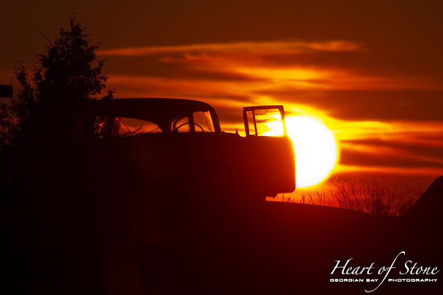 Sunset behind 1957 Chevy, Bourchier Islands, Georgian Bay