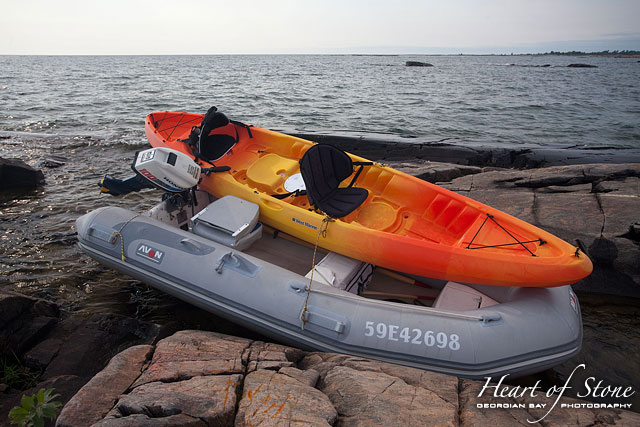 Kayak and dingy washed up on shore, Foster Island, Georgian Bay
