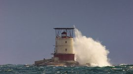 Wave breaking 70 feet over Red Rock lighthouse, Red Rock, Mink Islands, Georgian Bay