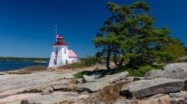 Lighthouse under blue skies, Brebeuf Island, Beausoleil Island National Park, Georgian Bay