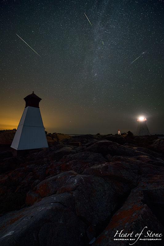 Perseids over lighthouse and twin ranges, Bustard Rocks, Bustard Islands, Georgian Bay
