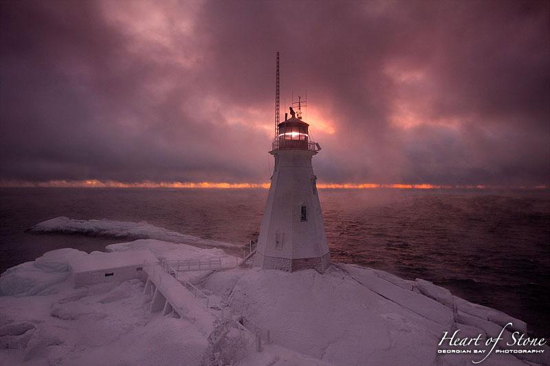 Winter sunrise over lighthouse on Doubletop Island, Western Islands, Georgian Bay
