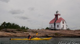 Snug Harbour lighthouse and kayaker, Snug Harbour, Georgian Bay