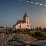 Progression of 2017 solar eclipse over lighthouse, Gereaux Island, Georgian Bay